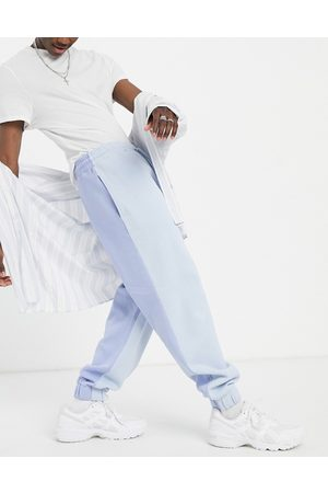 Reclaimed Vintage Inspired spliced colour block jogger co-ord in blue