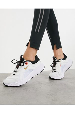 Nike Escape Run trainers in and gold