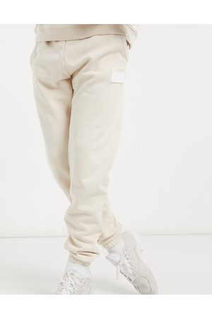 adidas RYV rubber badge joggers in cream