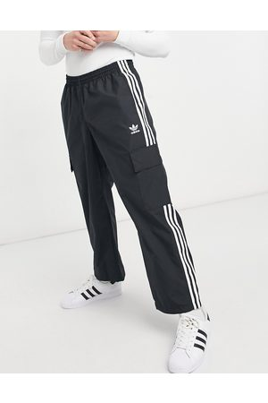 adidas Adicolor three stripe cargo trousers with pocket detail in