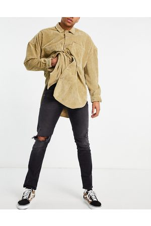 ASOS Stretch slim jeans in washed with heavy rips