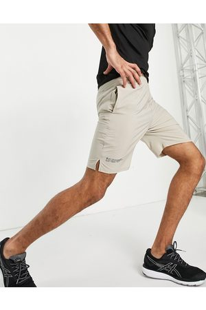 HIIT Running mid length woven running shorts in stone