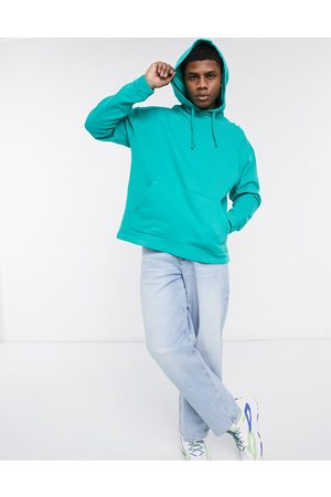 ASOS Oversized hoodie in washed green