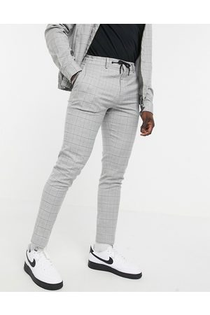 ASOS Co-ord smart skinny trousers with draw cord waist in grid check grey marl