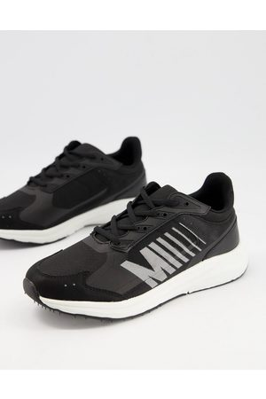 ASOS Sporty trainers in black