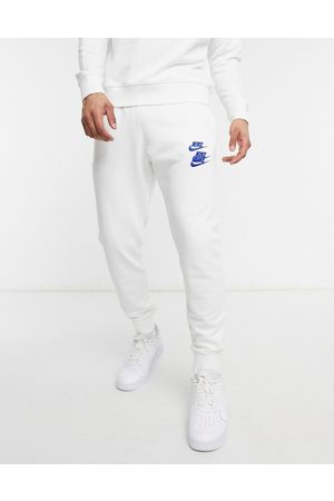 Nike Men Joggers - World Tour Pack graphic cuffed joggers in
