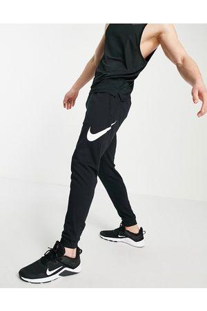 Nike Men Joggers - Swoosh joggers in