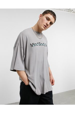 ASOS Oversized t-shirt in washed rib with text embroidery