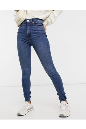 Monki Women Skinny - Oki organic cotton skinny high waist jeans in new mid