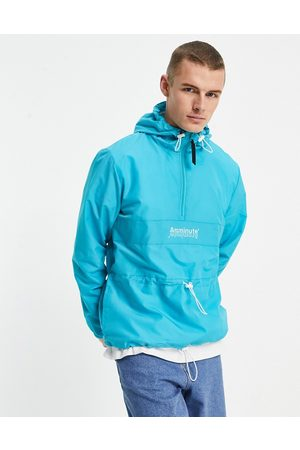 The Arcminute Men Sports Jackets - Arcminute nylon overhead cut and sew windbreaker in teal