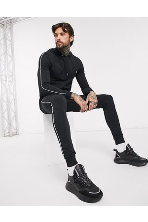 ASOS Organic muscle tracksuit with hoodie & piping in