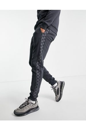River Island Monogrammed joggers in