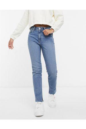 ASOS Mid rise vintage 'skinny' jeans in midwash with split hem