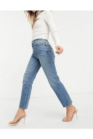 ASOS High rise stretch 'effortless' crop kick flare jeans in midwash with thigh rip