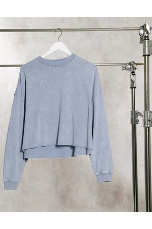 ASOS DESIGN Oversized sweatshirt with raw edge detail in wash in washed