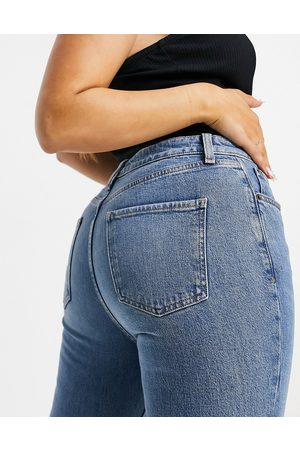 ASOS Hourglass mid rise vintage 'skinny' jeans in midwash with rips