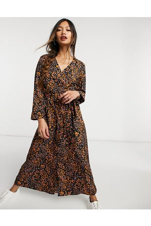 Vero Moda Exclusive wrap midi dress in animal print-Multi