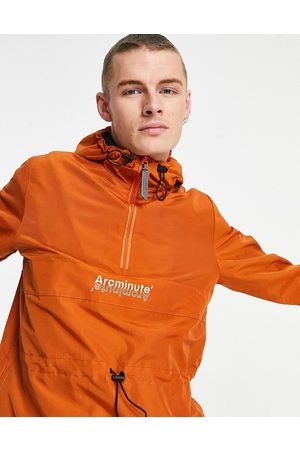 The Arcminute Arcminute nylon overhead cut and sew windbreaker in rust