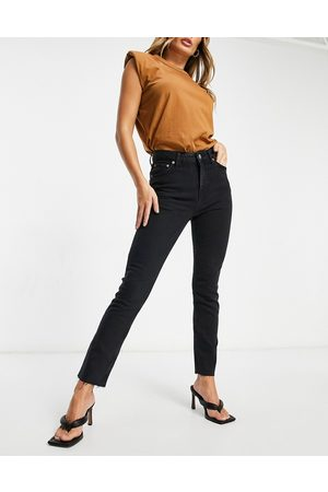 ASOS Mid rise vintage 'skinny' jeans in washed black