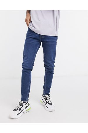Weekday Cone tapered jeans in sway wash