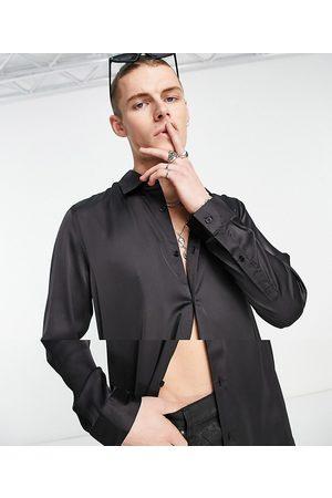 ASOS DESIGN Longline satin shirt in