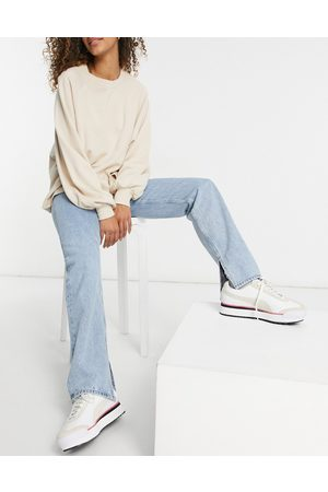 ASOS Mid rise '90s' straight leg jeans in stonewash with split hem