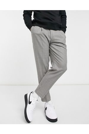 Topman Tapered check trousers in black and white
