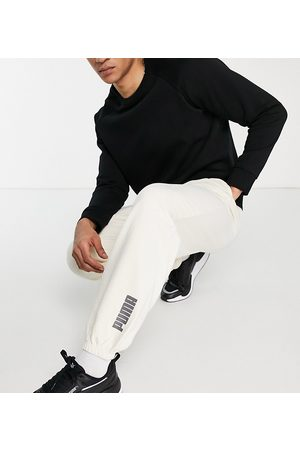 PUMA Oversized joggers in washed off exclusive to ASOS