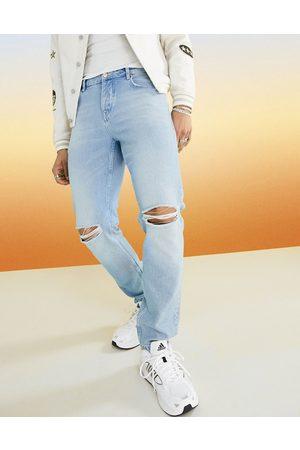 ASOS DESIGN Men Slim - Slim jeans in vintage light wash with knee rips