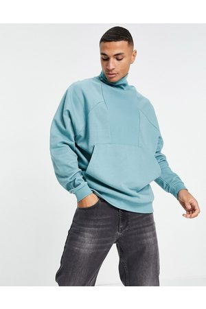ASOS Oversized turtle neck sweatshirt with rib panel in pastel blue