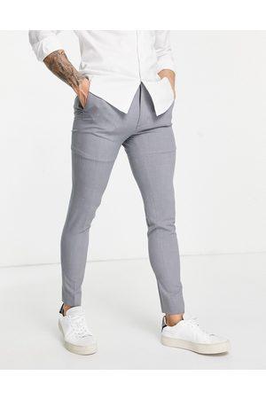 ASOS Super skinny suit trousers in mid