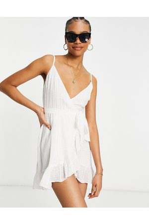 ASOS Tie wrap around mini sundress in self grid check in