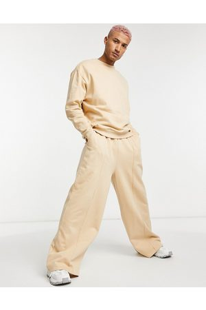 ASOS Tracksuit with oversized sweatshirt and oversized wide leg jogger-Neutral