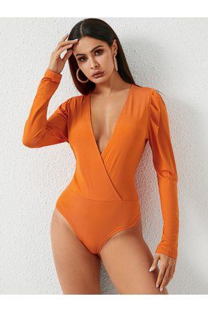 YOINS Orange Wrap Design Deep V Neck Long Sleeves Bodysuit