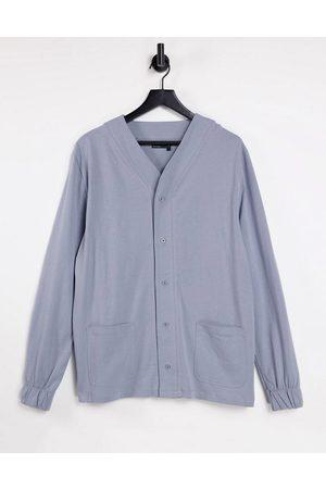 ASOS Relaxed long sleeve button through jersey t-shirt in