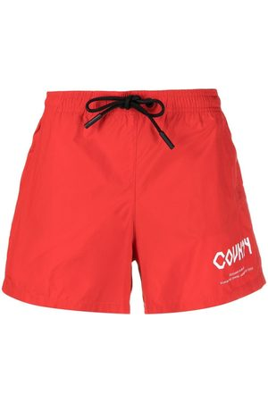 MARCELO BURLON Logo print swimming shorts