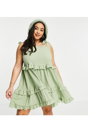 ASOS ASOS DESIGN Curve textured ruffle swing mini sundress with tie straps in khaki