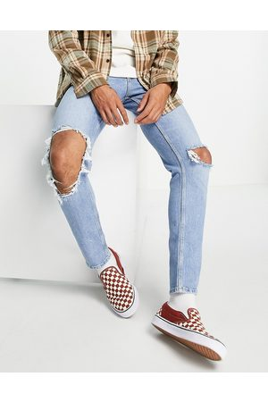 ASOS Stretch slim jeans in vintage light wash with open knee rip