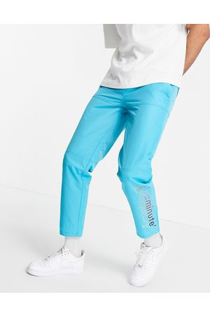 The Arcminute Arcminute nylon joggers in teal