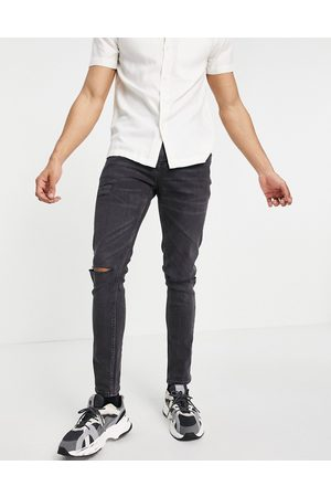 ASOS Skinny jeans in washed with knee rips