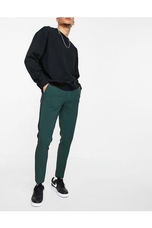 ASOS Super skinny tuxedo in dark green suit trousers