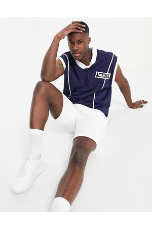 ASOS Basketball vest with embroidered chest logo in navy