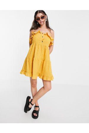 ASOS Bandeau tiered mini sundress in seersucker in mustard