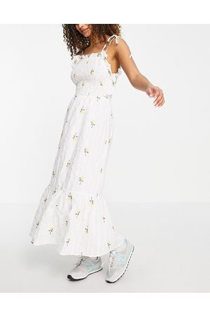 ASOS Textured shirred midi dress with floral embroidery in