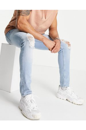 ASOS Skinny jeans in light wash with knee rips