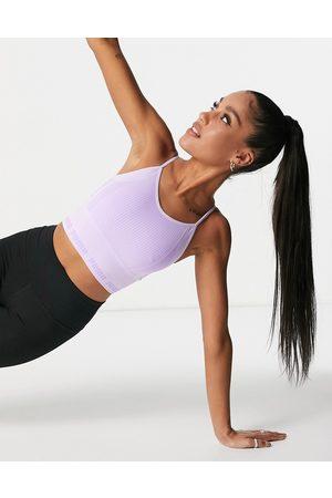 PUMA Women Sports Bras - Training Evoknit seamless light support sports bra in lilac