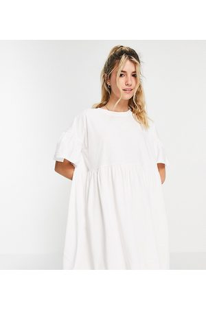 In The Style X Olivia Bowen exclusive smock dress with fluted sleeves in