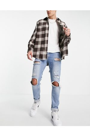 ASOS Skinny jeans in vintage mid wash with heavy rips