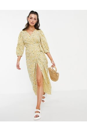 Vila Women Printed Dresses - Wrap dress with 3/4 balloon sleeve in yellow floral-Multi