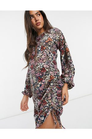 Vero Moda Bodycon mini dress with ruching detail in mixed floral